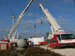 Joint work of cranes in a pre-assembly of wind equipment